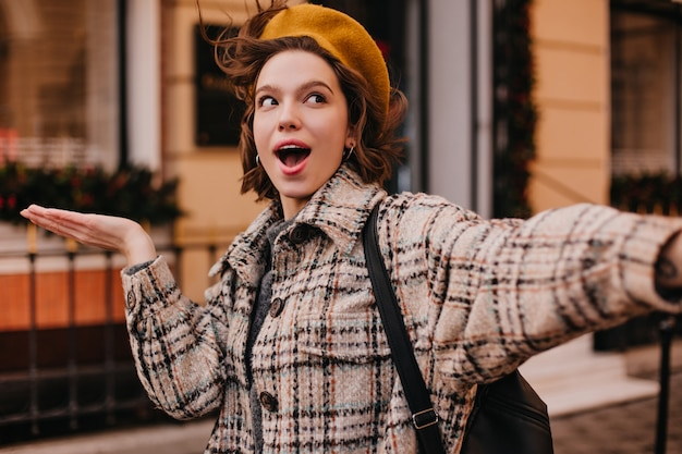 Selfie of funny woman student in checkered coat Free Photo