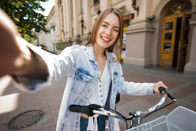 Selfie of a woman with bicycle Free Photo