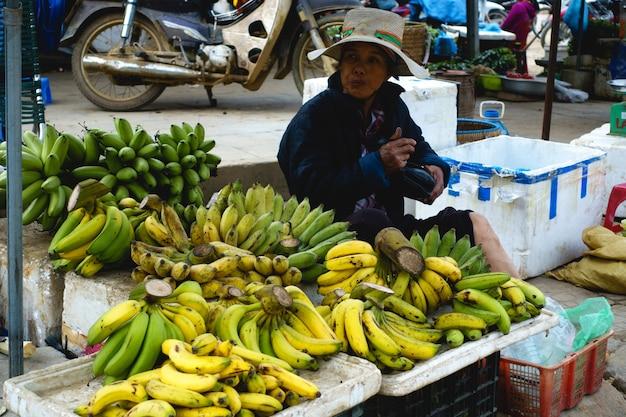 Selling bananas at asian market Free Photo