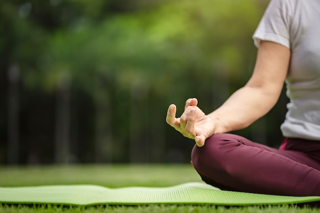 Senior asian woman practicing yoga exercise outdoor in the morning. senior healthy lifestyle Premium Photo