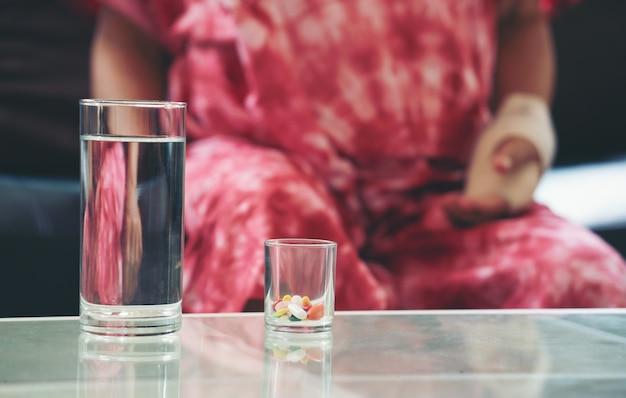 Senior asian woman take pill medicine on hand Premium Photo