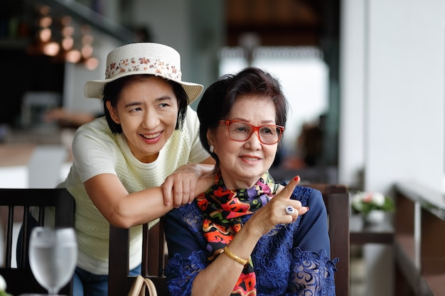Senior asian woman with daughter relaxing on vacation together. Premium Photo