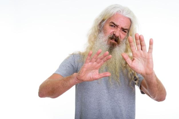 Senior bearded man looking disgusted Premium Photo