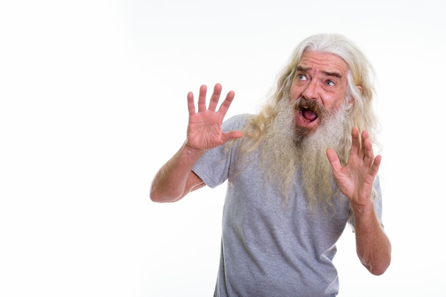 Senior bearded man looking scared Premium Photo