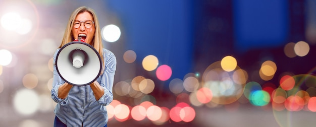 Senior beautiful woman with a megaphone Premium Photo