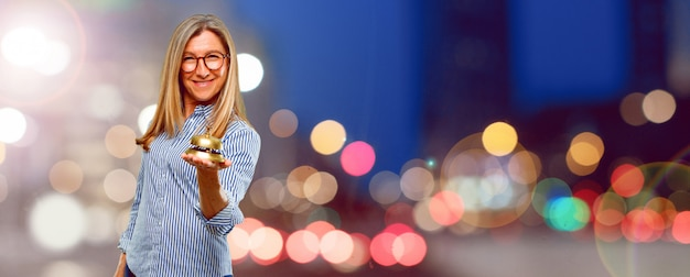 Senior beautiful woman with a ring bell Premium Photo