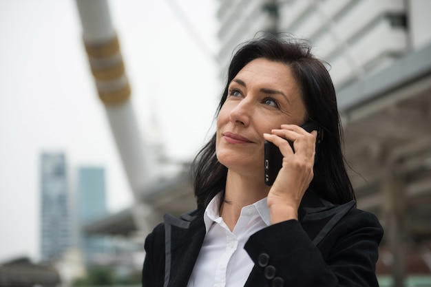 Senior businesswoman discuss project by smartphone Premium Photo