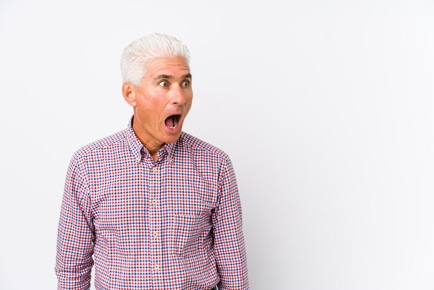 Senior caucasian man isolated being shocked because of something she has seen. Premium Photo