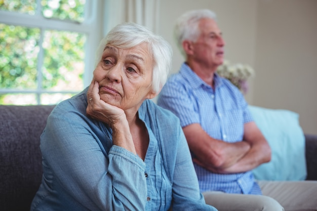 Senior couple after arguing while sitting on sofa Premium Photo
