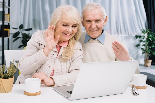 Senior couple doing video call Free Photo
