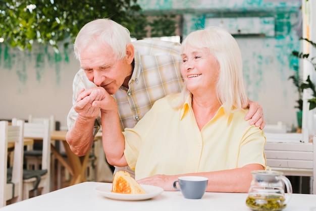 Senior couple enjoying together having meal Free Photo
