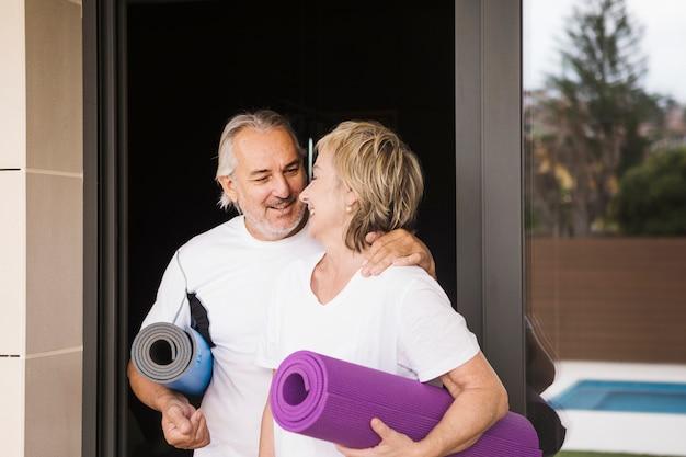 Senior couple excising in garden Free Photo