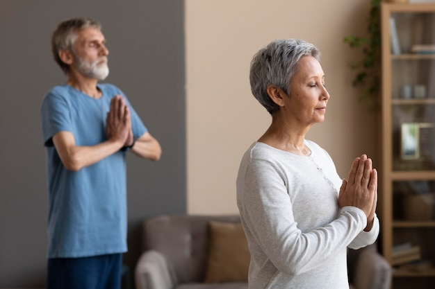 Senior couple exercising together at home Free Photo