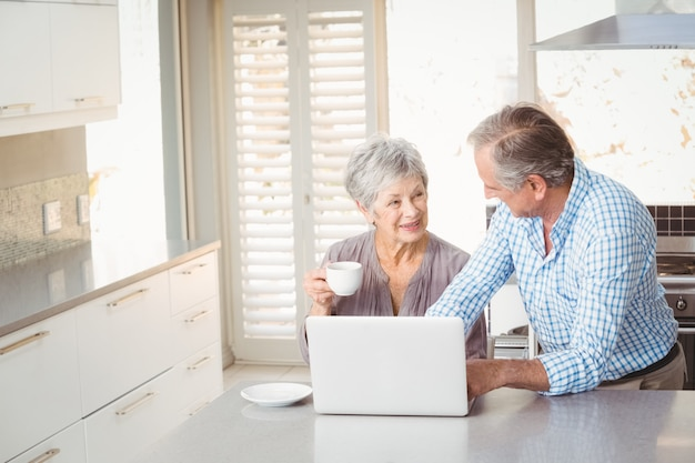 Senior couple interacting in kitchen Premium Photo