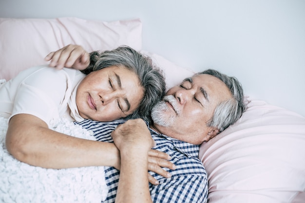 Senior couple lying in bed together Free Photo