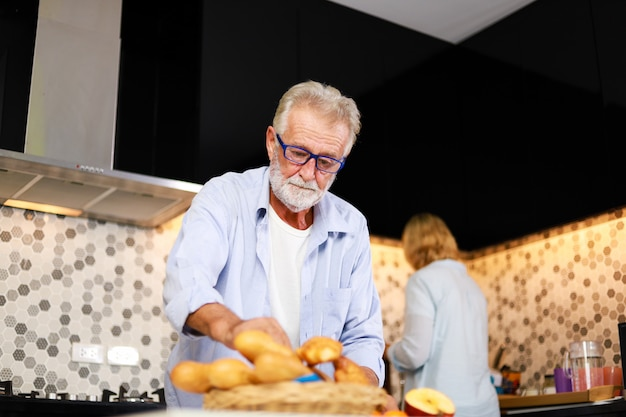 Senior couple man and woman cooking in kitchen happy mood Premium Photo
