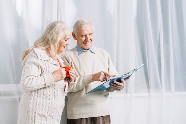 Senior couple reading book Free Photo