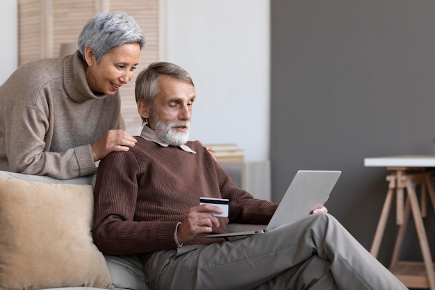 Senior couple relaxing at home Free Photo