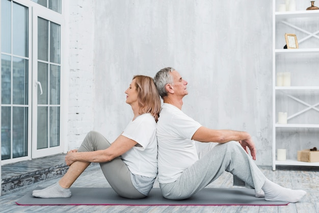 Senior couple resting after exercise in living room Free Photo