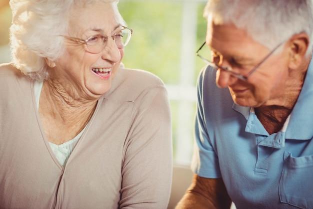 Senior couple smiling at home Premium Photo