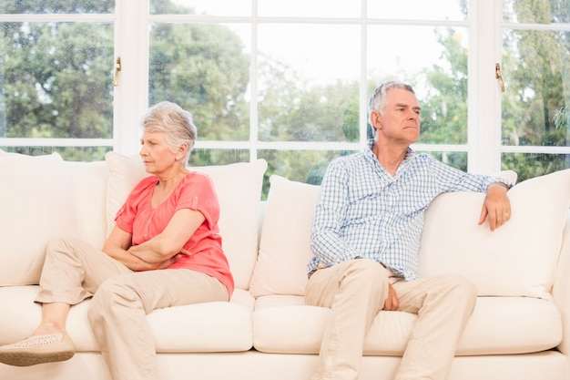 Senior couple not speaking after an argument on the sofa Premium Photo