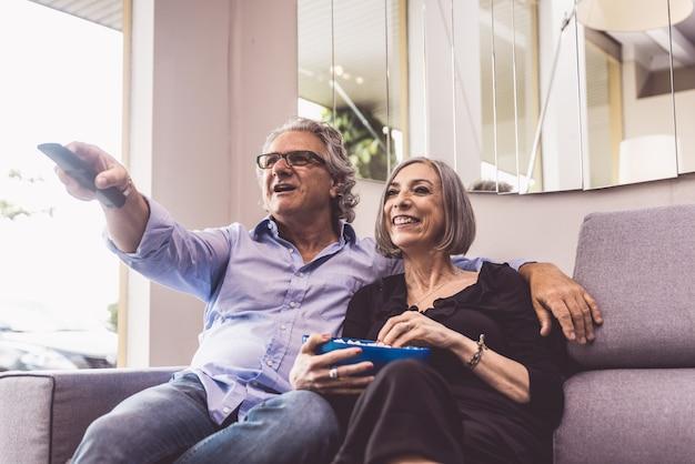 Senior couple spending time in the living room Premium Photo