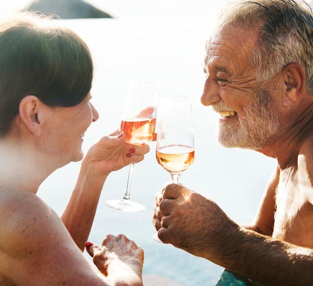 A senior couple toasting Premium Photo