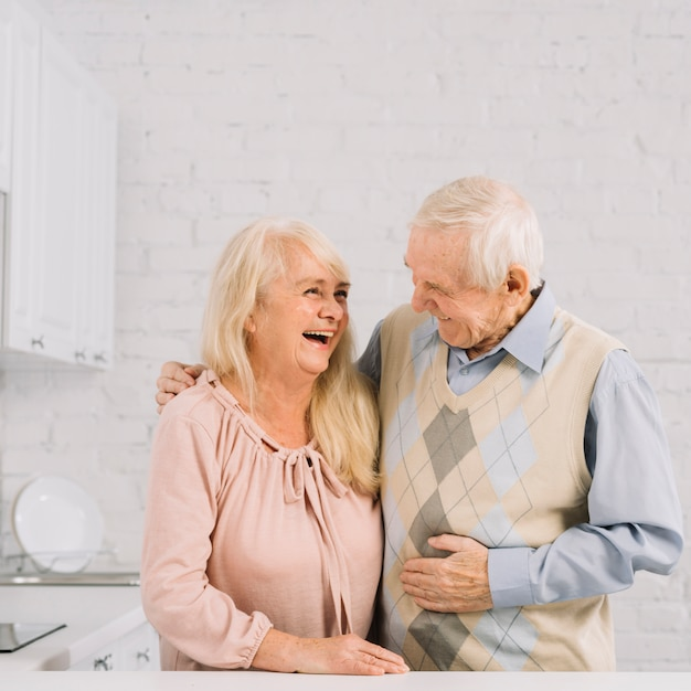 Senior couple together in kitchen Free Photo
