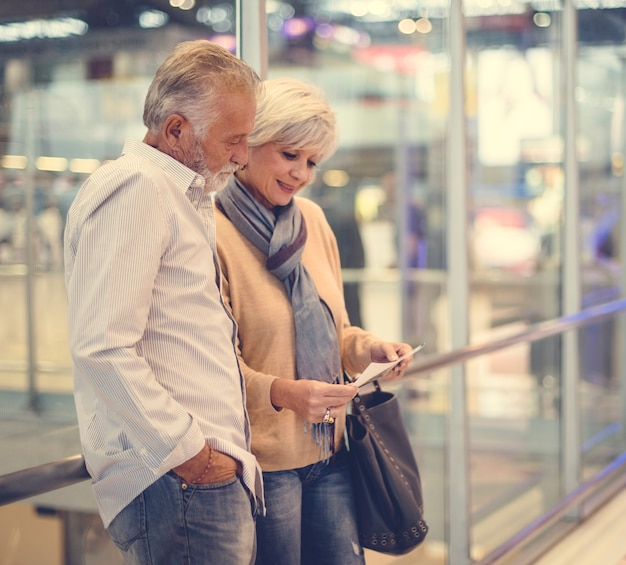 Senior couple traveling airport scene Free Photo