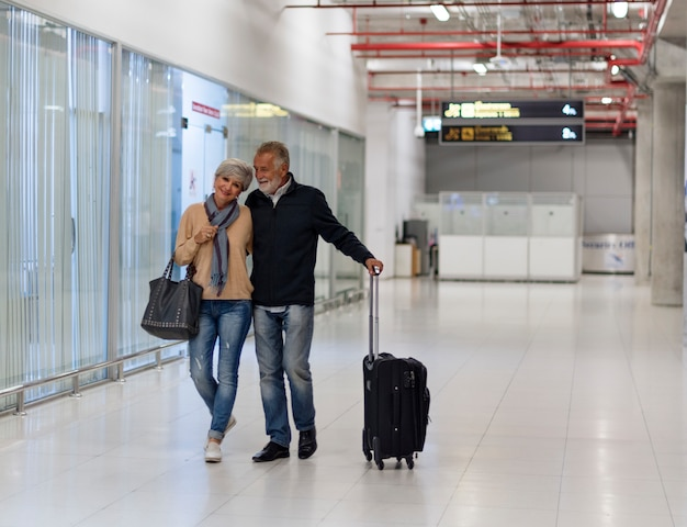 Senior couple traveling airport scene Free Photo
