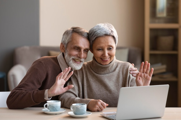 Senior couple vide conferencing at home Free Photo