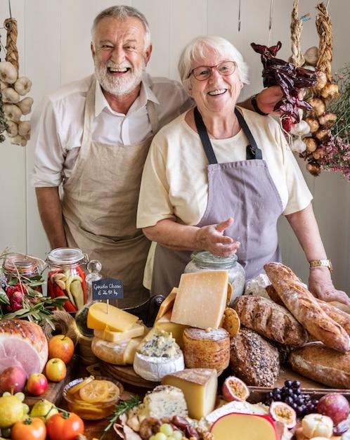 Senior couple working at a farm shop Premium Photo