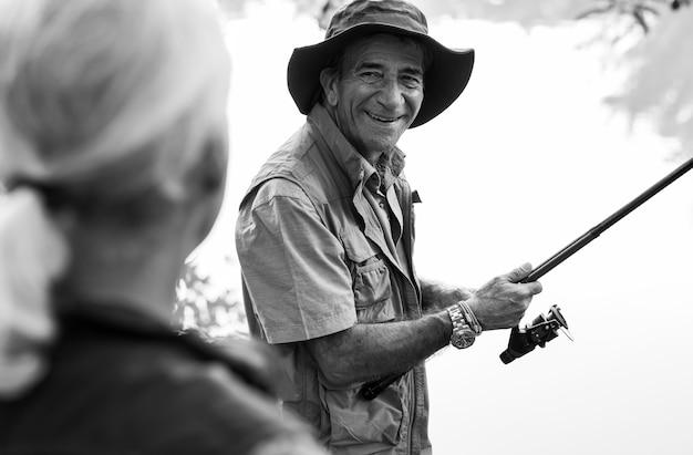 Senior friends fishing by the lake Free Photo