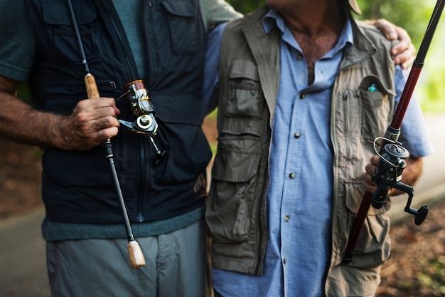 Senior friends fishing by the lake Premium Photo