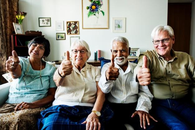 Senior friends gesturing thumbs up Premium Photo