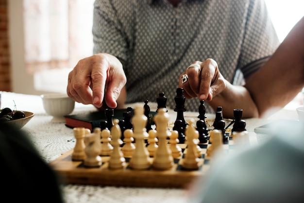 Senior friends playing chess together Premium Photo