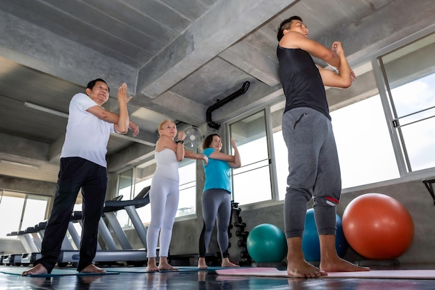 Senior group attractive stretching at fitness gym. Premium Photo