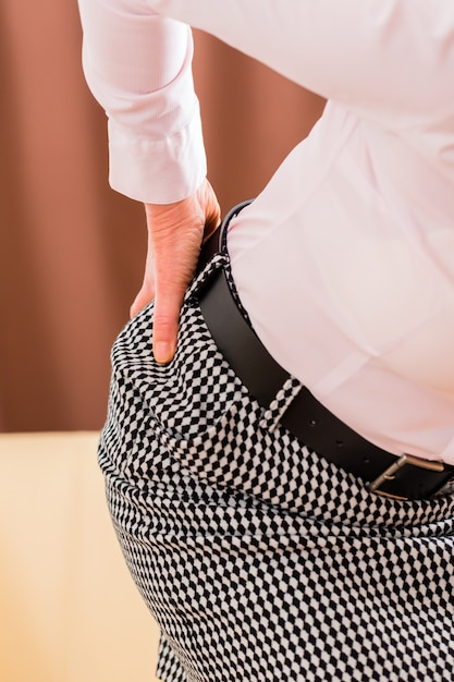 Senior having back pain at home Premium Photo