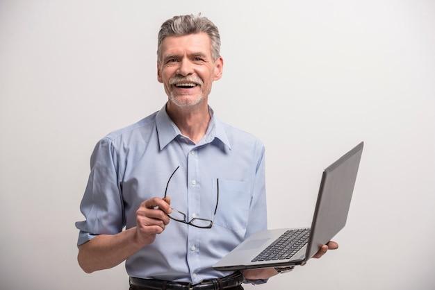 Senior male in glasses with laptop Premium Photo