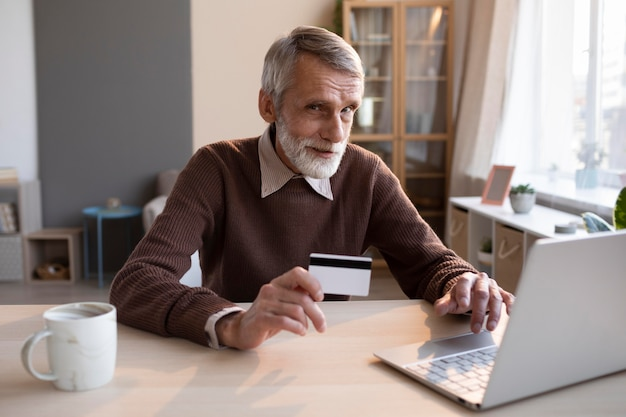 Senior male ready to shop online Free Photo