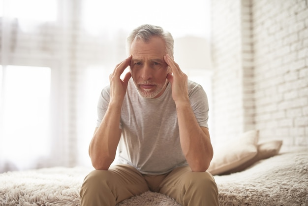 Senior man suffering from headache stroke symptom Premium Photo