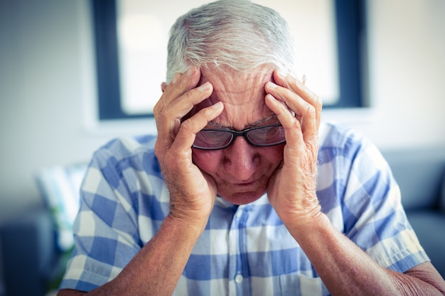 Senior man suffering from headache Premium Photo