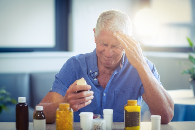 Senior man suffering from headache Premium Photo