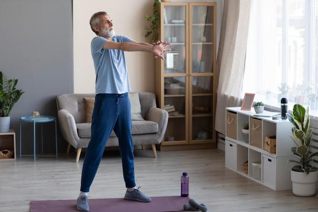 Senior man training at home Premium Photo