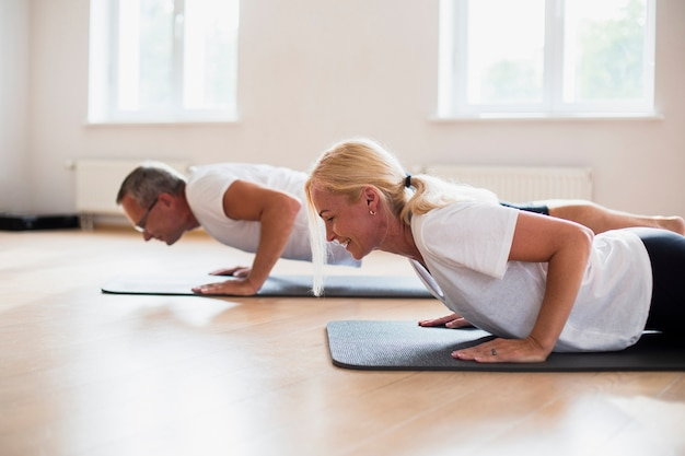 Senior man and woman practicing together Free Photo