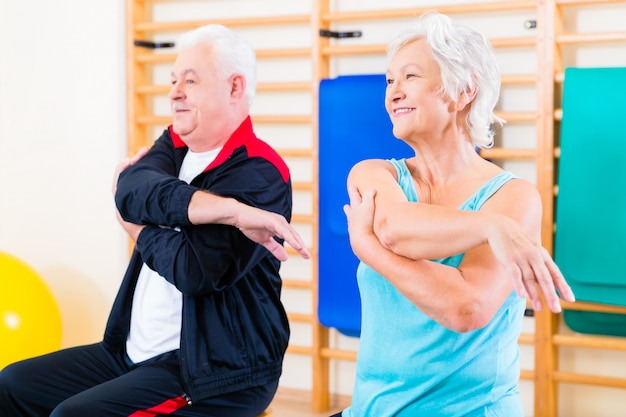 Senior people in fitness exercise Premium Photo