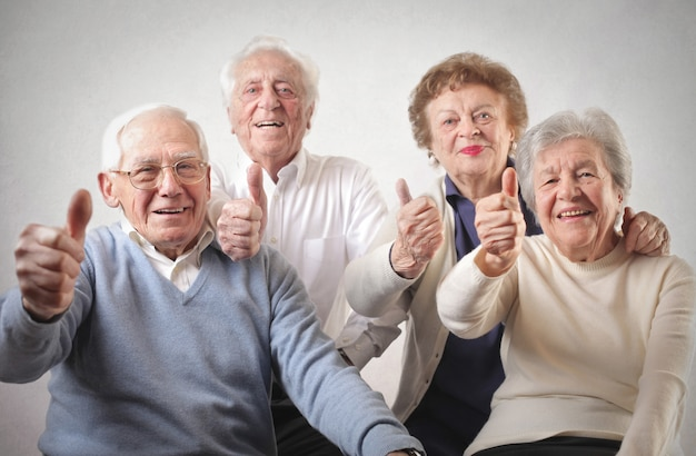 Senior people with thumbs up Premium Photo