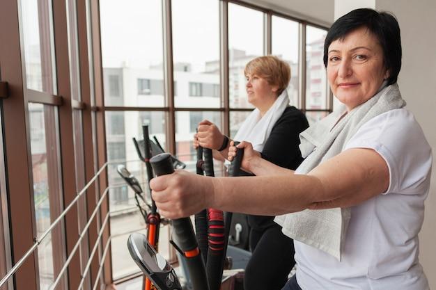 Senior smiley women on treadmill Free Photo