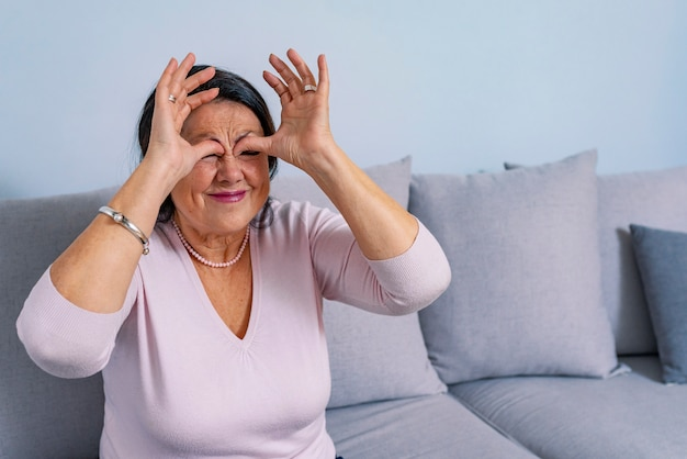 Senior with sinusitis Premium Photo