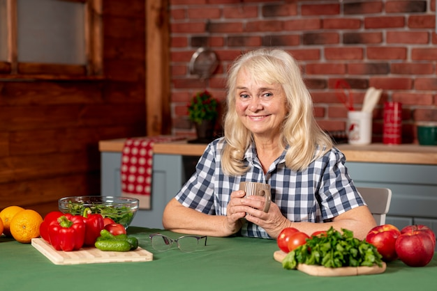 Senior woman cooking healthy food Free Photo